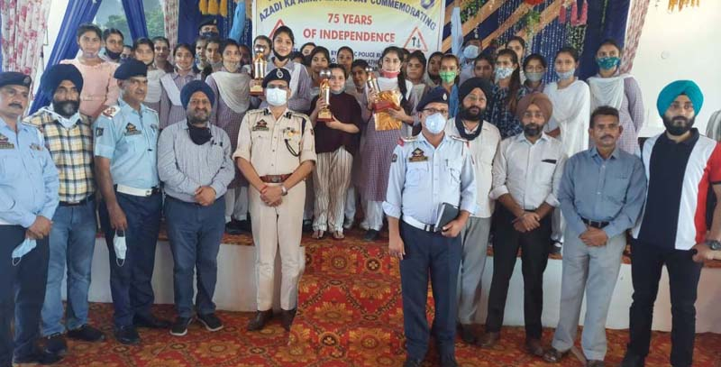Winners of debate competition posing for a group photograph with SSP Traffic Rural and other dignitaries at Vijaypur on Monday.