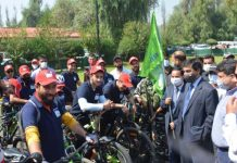 Chief Secretary Dr Arun Kumar Mehta flagging off cycling expedition along with others at Srinagar on Monday.