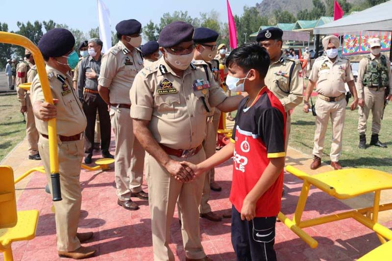 DGP Dilbag Singh interacting with a child during inaugural ceremony of 'Open Air Gym' at Zewan Srinagar.