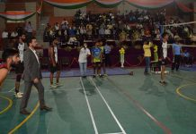 Sports Minister Anurag Thakur participating in Volleyball match at Budgam on Monday.