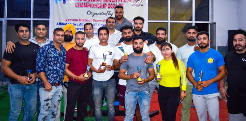 Winners displaying trophies during Wrestling championship in Jammu.