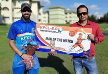 A player being awarded with man of the match by a dignitary at Jammu.
