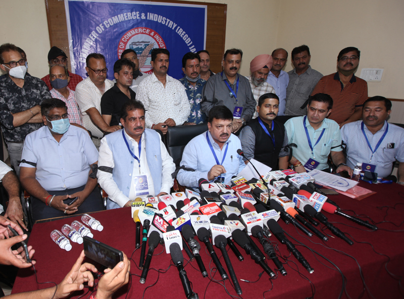Chamber of Commerce and Industry president Arun Gupta, flanked by others addressing press conference in Jammu. —Excelsior/Rakesh