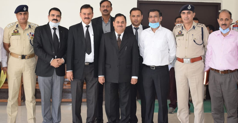 Judicial, police and civil officers during a meeting.