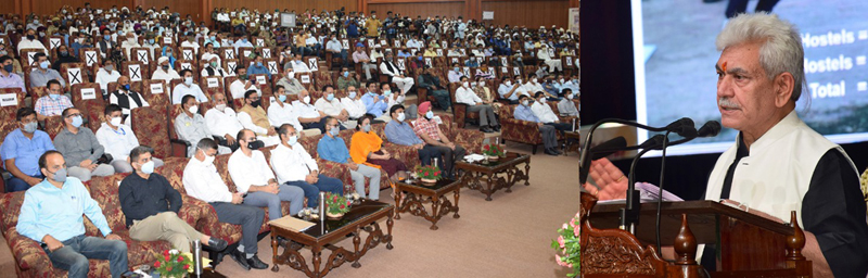 Lt Governor addressing the gathering of tribal communities at Convention Centre in Jammu on Saturday.