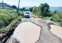 Water filled potholes on Ballian-Battal road.