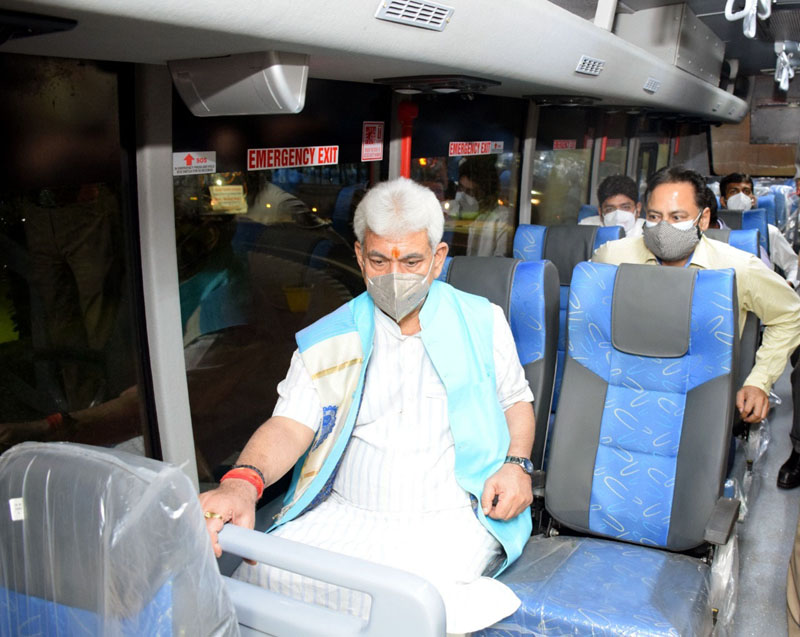 Lt Governor, Manoj Sinha takes a ride in a bus after flagging off first lot of 95 new JKRTC buses in Jammu.