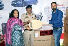 DGP Dilbag Singh awarding a winner of 32nd Police-Public Mela.