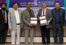 Dr Ajay Kumar Sood, CGM NABARD, Jammu Regional Office and J&K Bank officers posing for a group photograph.