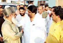 Senior Congress leader Raman Bhalla interacting with aggreived people of Belicharana of Gandhi Nagar constituency in Jammu on Monday.