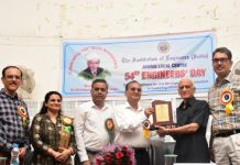 Er V N Sharma receiving IEI Award during National Engineers Day function at Jammu Local Centre of the Institution of Engineers (India).