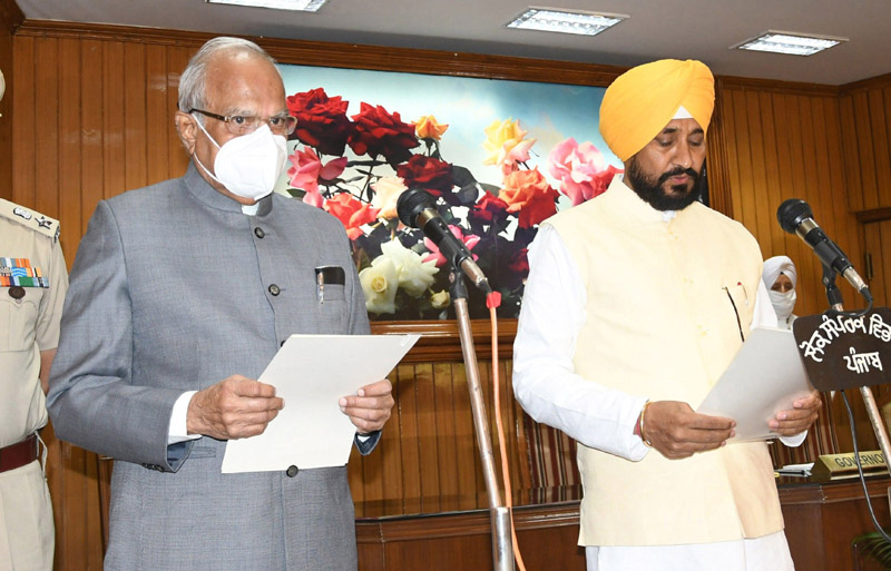 Punjab Governor Banwarilal Purohit administering the oath to Charanjit Singh Channi as Chief Minister of Punjab in Chandigarh on Monday. (UNI)