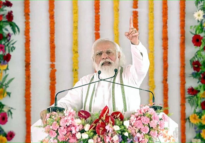 Prime Minister Narendra Modi addressing the foundation stone laying ceremony of Raja Mahendra Pratap Singh State Univeristy in Aligarh on Tuesday. (UNI)