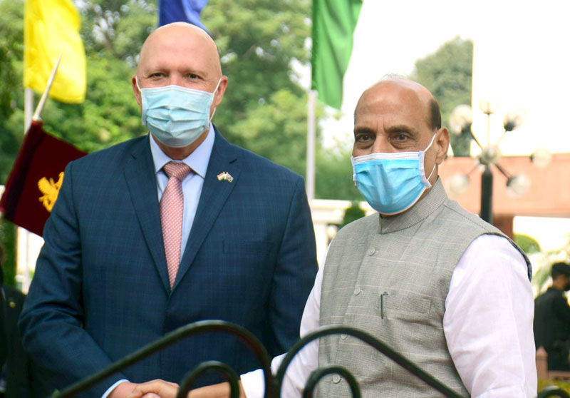Defence Minister of Australia Peter Dutton being received by Defence Minister Rajnath Singh at a ceremonial reception at Vigyan Bhavan lawn, in New Delhi on Friday. (UNI)