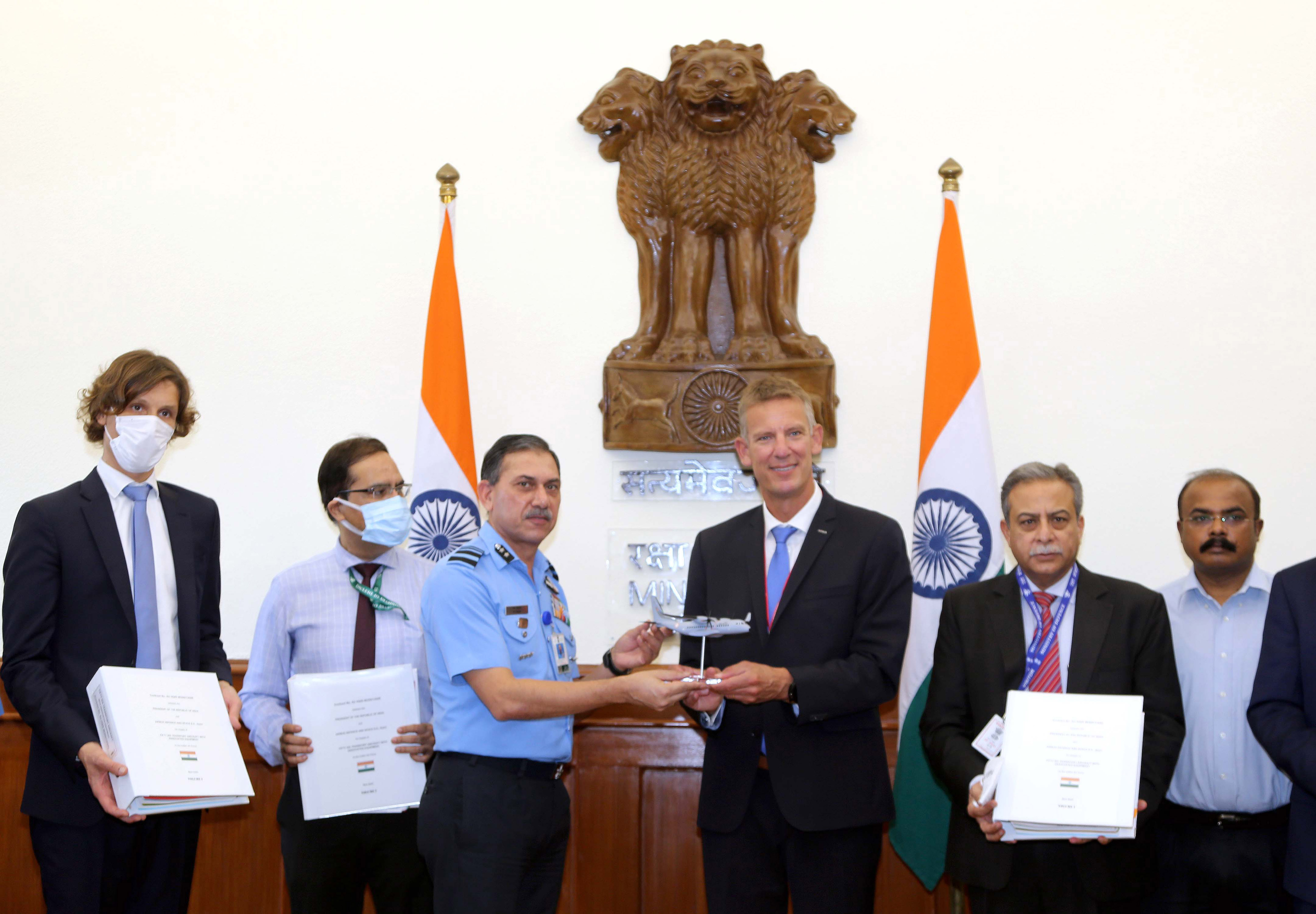 Ministry of Defence officials signed contract with Airbus Defence and Space, Spain for acquisition of 56 C-295MW transport aircraft for IAF, in New Delhi on Friday. (UNI)