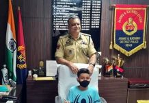 SSP Reasi Shailender Singh posing with a 6-year-old child after offering his chair to him.