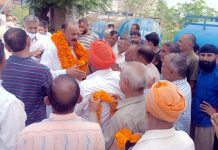 Senior NC leader Surjeet Singh Slathia interacting with people at a border village in Ramgarh area of Samba district.