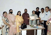 BJP secretary, Rekha Mahajan with party activists at Akhnoor on Thursday.