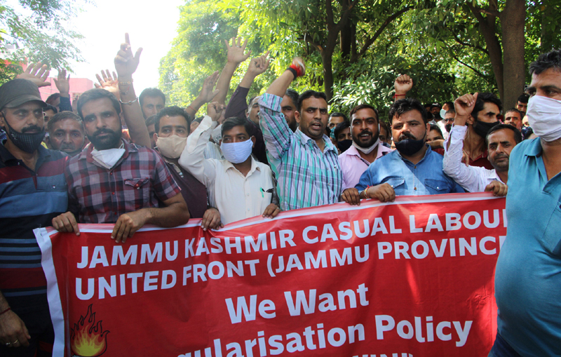 Casual labourers and daily rated workers staging protest demonstration in Jammu on Saturday. -Excelsior/ Rakesh