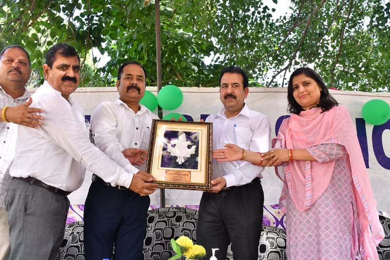 Director School Education Jammu Dr Ravi Shankar and others during a function organized by GHSS Bhalwal.