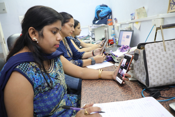 Teachers conducting online classes at HBET in Jammu.