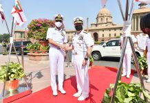 Chief of Naval Staff, Admiral Karambir Singh welcomes Chief of US Naval Operations, Admiral Michael Gilday during Guard of Honour at South Block in New Delhi on Tuesday. (UNI)