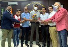 Newly elected team of RBBA presenting bouquet to DC Jammu Anshul Garg.
