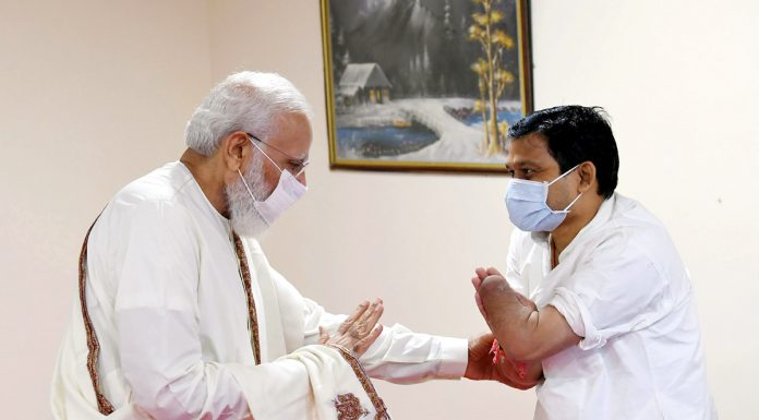 Prime Minister Narendra Modi meeting a beneficiary during his visit to the vaccination center at Ram Manohar Lohia hospital in New Delhi on Thursday. (UNI)