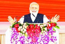 Prime Minister Narendra Modi addressing at the inauguration of 9 Medical Colleges, in Siddharthnagar, Uttar Pradesh on Monday. (UNI)