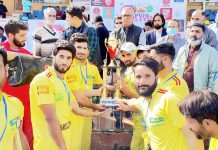 Advisor Farooq Khan inaugurating sports event along with sports enthusiasts at Baramulla on Tuesday.