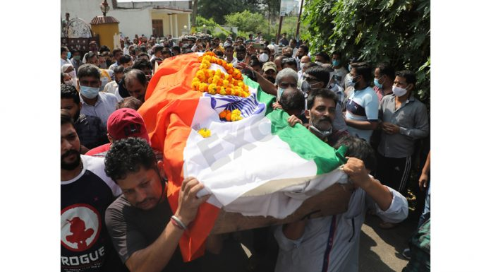 The body of Deepak Chand Mehra being taken to cremation ground for last rites on Friday. — Excelsior/Rakesh