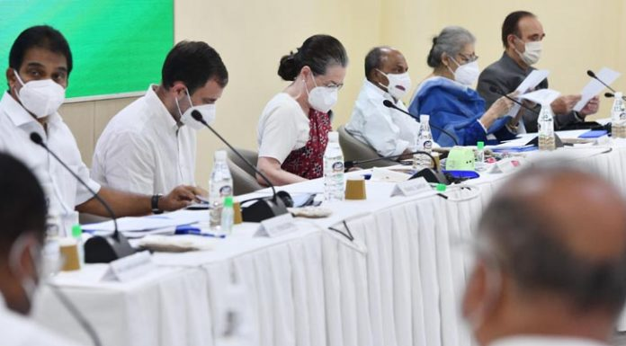 Congress president Sonia Gandhi with party MP Rahul Gandhi and other senior leaders during CWC meeting in New Delhi on Saturday. (UNI)