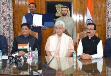 Union Minister Piyush Goyal and Lt Governor Manoj Sinha during signing of MoU between J&K and Government of Dubai.
