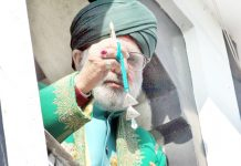 Head cleric displaying Holy Relic at Dargah Hazratbal on Tuesday. -Excelsior/Shakeel