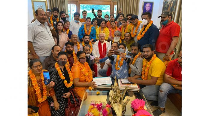 Former CM Dr Farooq Abdullah with Kashmiri Pandits at his Bhatindi residence on Friday. -Excelsior /Rakesh