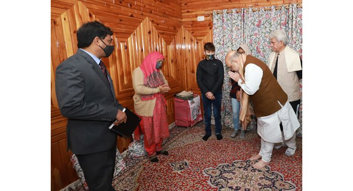 Union Home Minister Amit Shah bows to family members of martyr JKP Inspector Parvaiz Ahmed Dar at their residence in Srinagar on Saturday.