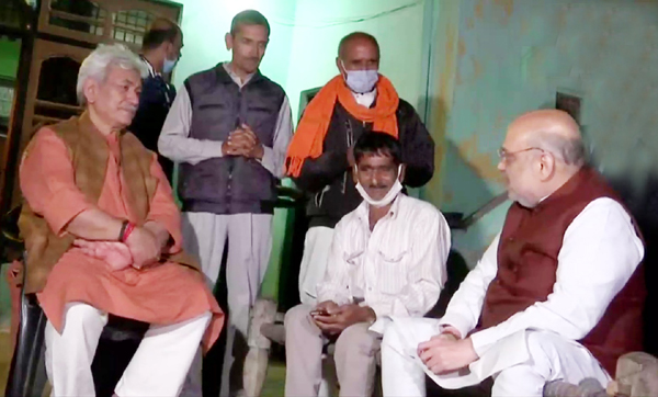 Union Home Minister Amit Shah interacting with local residents in Makwal border of Jammu on Sunday.