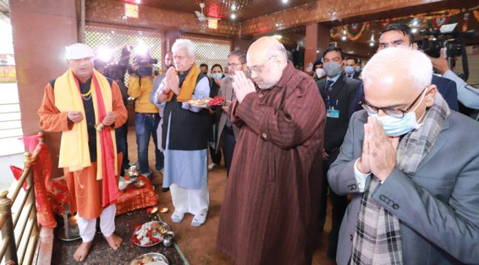 Union Home Minister Amit Shah paying obeisance at Kheer Bhawani temple in Tulmulla area of Ganderbal district on Monday.