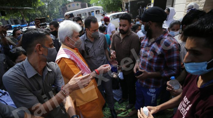 LG Manoj Sinha interacting with the protesting NHM employees outside GMC Jammu on Sunday . -Excelsior/Rakesh