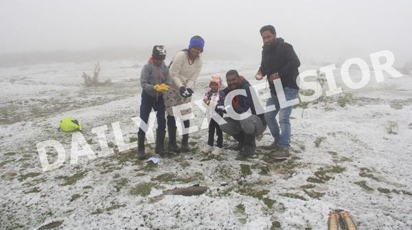 Tourists enjoying season's first snowfall in Gulmarg. —Excelsior/Aabid Nabi