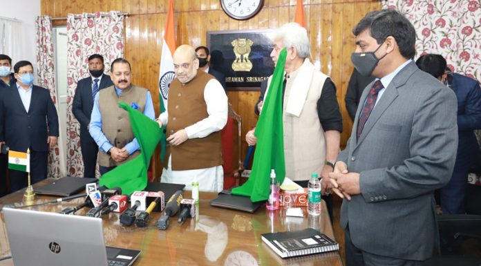 Union Home Minister Amit Shah flags off Srinagar-Sharjah international flight in Srinagar along with Union MoS in PMO Dr Jitendra Singh and Lieutenant Governor Manoj Sinha.