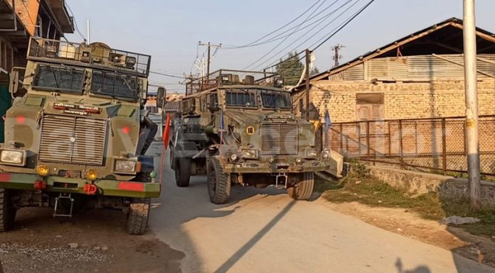 Security forces near encounter site at Drangbal in Pampore on Saturday. —Excelsior/Younis Khaliq