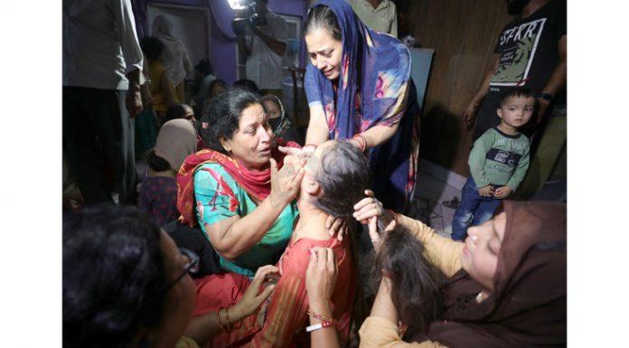 Family members of Deepak Chand Mehra wailing at Jammu on Thursday. —Excelsior/Rakesh