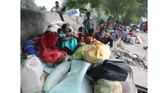 Migrant workers staying near Jammu Railway Station after fleeing from Kashmir. -Excelsior/Rakesh