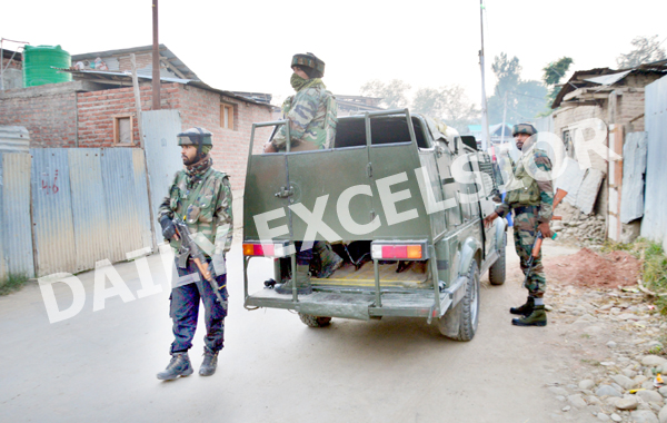 Security forces near encounter site at Wahibugh in Pulwama district on Friday. -Excelsior/Younis Khaliq