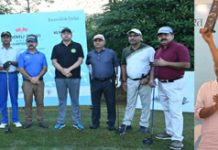 Divisional Commissioner Dr Raghav Langer and participants posing for a group photograph (L) Winner of Golf Championship Vedant Handa (R).