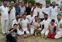 Winners posing for a group photograph with trophies at KC Ground Jammu.