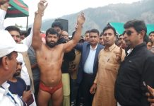 Chief guest declaring winner of the wrestling championship along with other dignitaries at Bhaderwah on Sunday.
