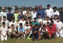 Participants and dignitaries posing for a group photograph at Khel Gaon Nagrota on Saturday.