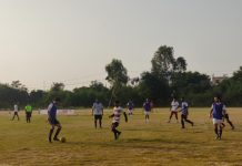 Players in action during a footbaal match at Sainik Ground, Sainik Colony in Jammu.
